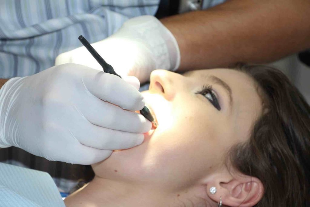 Dentist working on a female patient