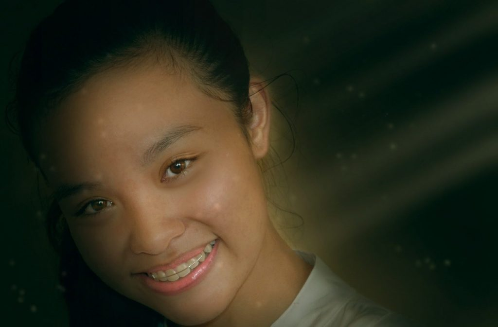 Young girl smiling with braces